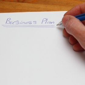 Creating a Business Plan for a Small Business, A handwritten business plan on paper.