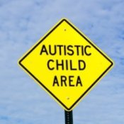 Parenting an Autistic Child, Diamond shaped traffic sign warning, autistic child area.
