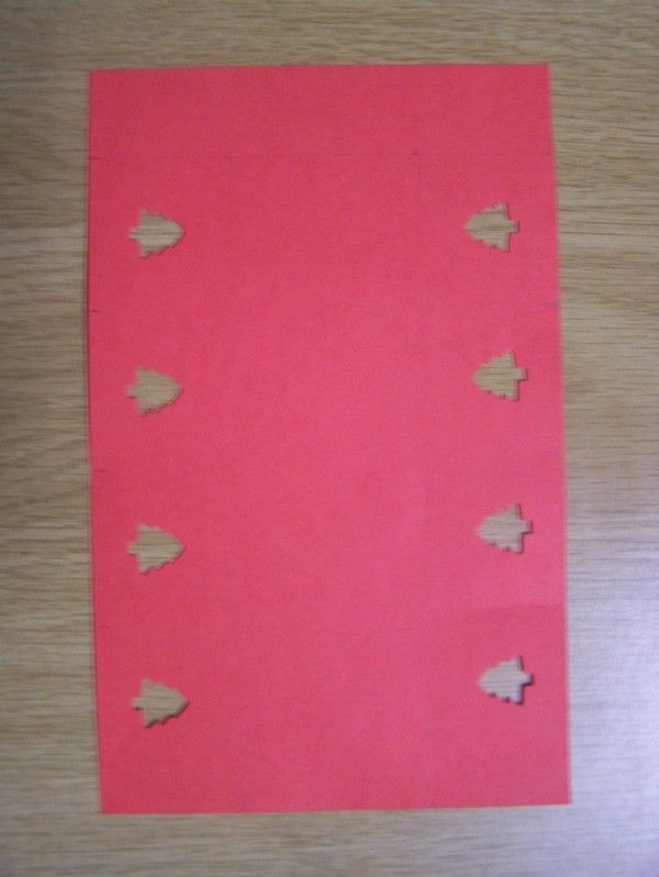 Red Paper with tree shaped hole punches