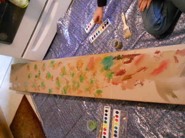 Painting tree trunk.