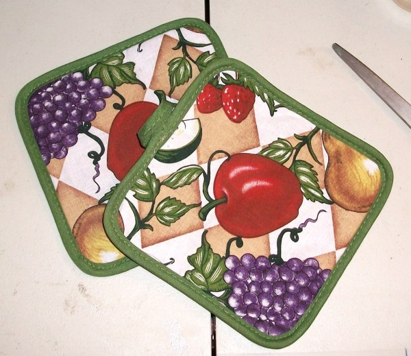 Two pot holders with fruit motif.