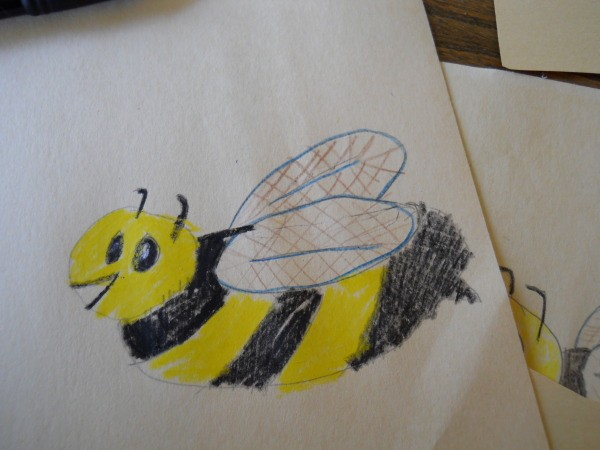 Colored drawing of a honey bee.