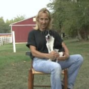 Housebreaking a Puppy, Woman With Puppy on Her Lap