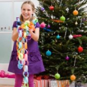 Stick to Your Holiday Budget: Family, Holiday Activities, Girl with Paper Chain Garland