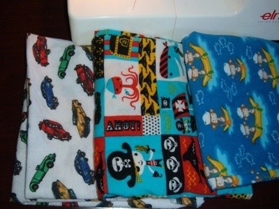 Homemade pillowcases with colorful designs.