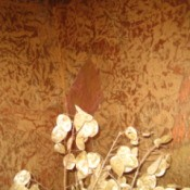 View of the corner of bath with painted brown bag wallpaper.