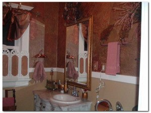 View of bath mirror and sink area.