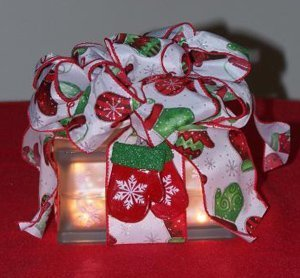 Glass block gift wrapped as a package.