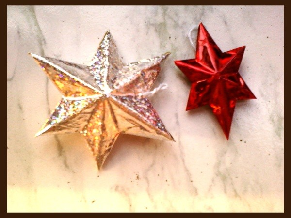 Completed stars, one iridescent silver and one red.
