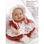 Baby doll with crochet hat, dress, and shoes.