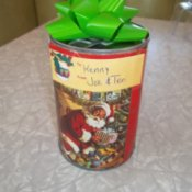Can with gift wrap and a bow.