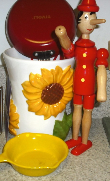 Sunflower canister and wooden Pinocchio doll.