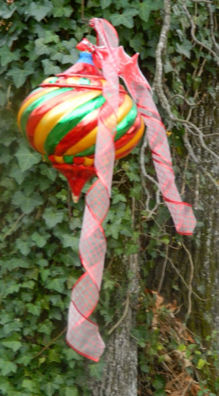 Large brightly colored ornament with decorative ribbon.