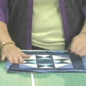 How to Quilt, Woman Piecing Together a Quilt