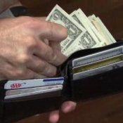 How to Save Money, Man taking money from his wallet.