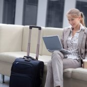 Business Travel Tips, Business Woman on Laptop in Airport