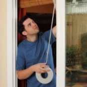 Weatherizing Your Home, Man Weather Stripping His Windows