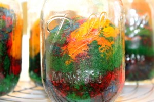 Rainbow cake baked in a mason jar.