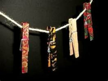 Brightly colored painted wooden clothespins.