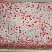 A Valentine's Day cake with pink and red candy confetti.