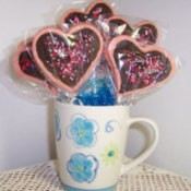 A bouquet of heart shaped cookies in a coffee cup, for Valentine's Day.