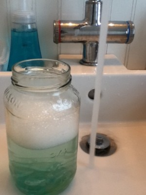 Baby wash and water in marble mason jar.