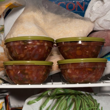 4 glass bowls full of soup in the freezer.