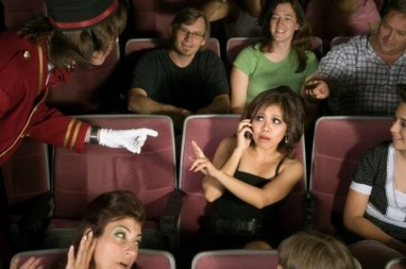 Cell Phone Etiquette, Woman on Cell Phone in Movie Theater