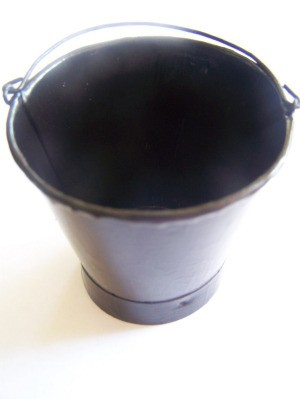 Small bucket painted on inside with black paint.