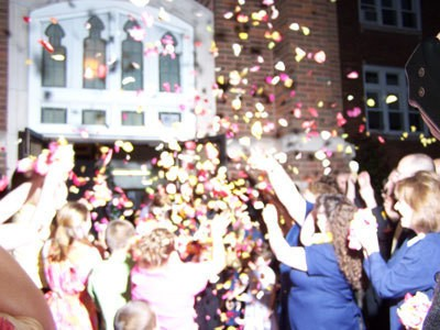Flower petals being thrown at a wedding.