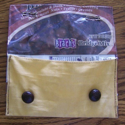 A pouch made from a Brach's Bridge Mix wrapper.
