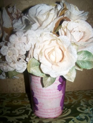 Add some artificial flowers to the vase.