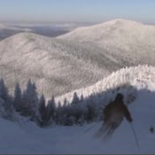 Best Budget Ski Vacations, Skier Coming Down Mountain