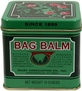 A green box of Bag Balm medicated ointment.