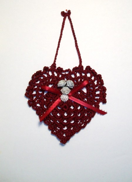 Completed heart with decorations and hanger.