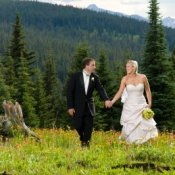A married couple in a moutain setting.