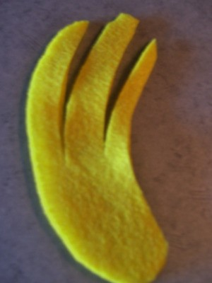 Cut felt banana peel.