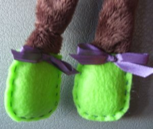 Closeup of green feet.