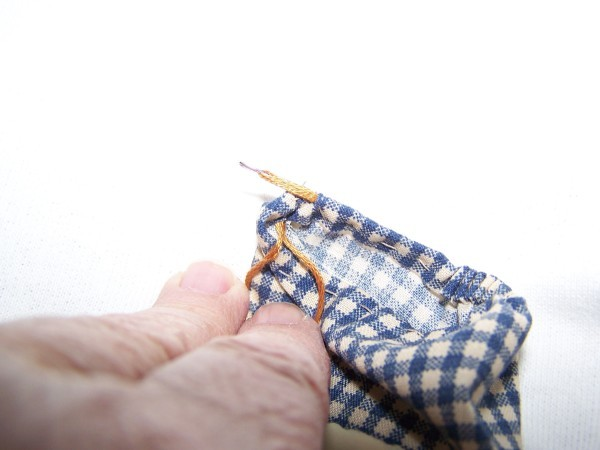Threading A Drawstring using a needle.