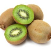 4 Kiwi fruits, one cut in half.