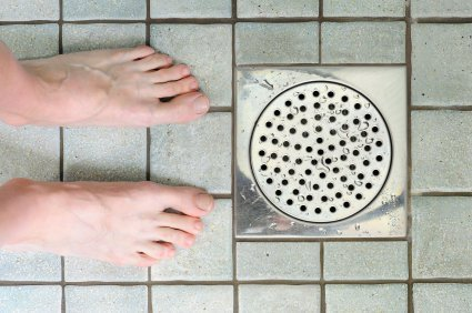 Feet near shower drain