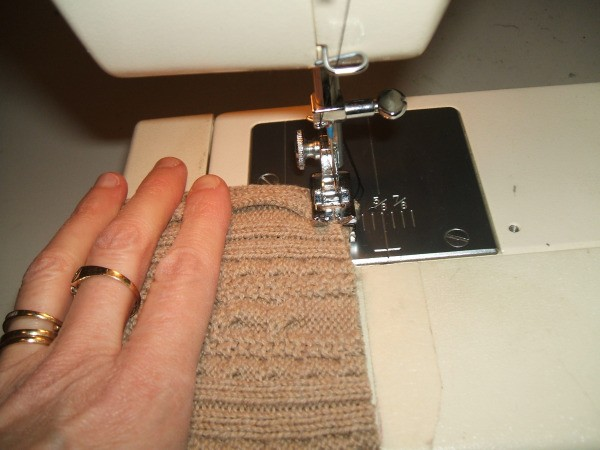 Sewing the cover on the machine.