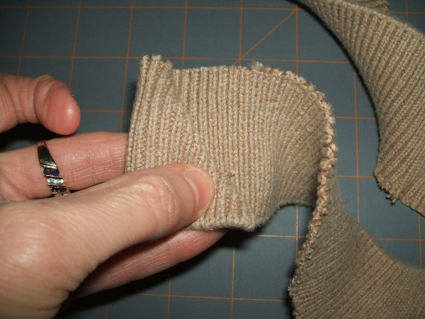 Holding one strip of the ribbed band.