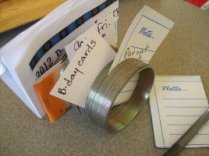 Reuse Slinky As Note Holder on your desk.