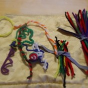 Stored pipe cleaners and some used for crafting shapes.