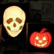 Two pumpkin and one skull light.