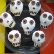 A plate of skull cupcakes.