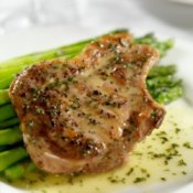 Seasoned pork chop on asparagus
