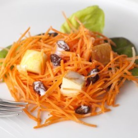 Carrot salad with cheese and raisens on lettuce