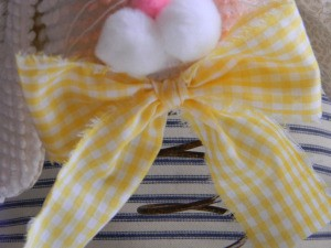Closeup of fabric bow.
